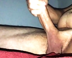 Stroking cock after a long day at work.