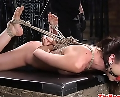 Restrained BDSM babe gets dominated over